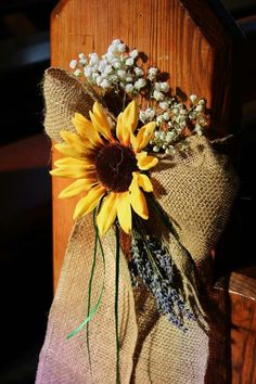 Sunflower pew ends wedding. We could totally do this.