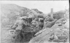 An Australian sniper and his spotters in the trenches