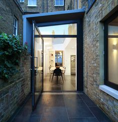 Platform 5 created a side extension and reconfigured the ground and first floors of a four storey mid terrace Victorian townhouse in Camden. The existing dark cellular ground floor rear wing was opened up and re-arranged to create a light filled room whe Ideal Home, House Extensions, Victorian Homes, Glass Extension, House Siding, Building A House, Architectural Inspiration, Victorian Townhouse, Roof Light