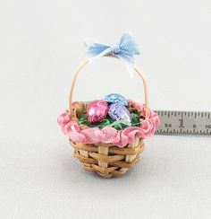 Dollhouse Miniature Decorated Easter Basket with Foil Wrapped Eggs. $9.99, via Etsy.