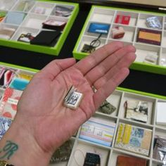 The tiniest book of all (with drawings of giant statues). Photo by Rebecca…