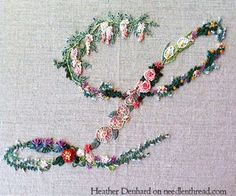 Hand Embroidered Monogram... neat done up in various floral stitches