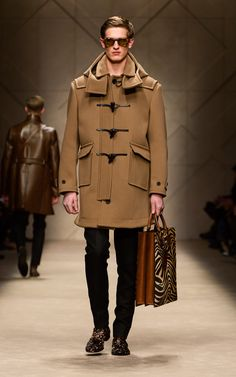Straw cavalry twill duffle coat and striped animal print tote on the runway of the Burberry A/W13 Menswear show
