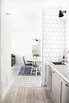 White, minimal kitchen and dining room | The Lifestyle Edit