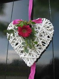 www.brigitteflowers.co.uk  wicker heart with gerbera to decorate your wedding venue, or lovely as unique pew-end. Made by Brigitte de Wert