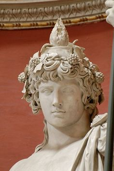 Detail - Colossal statue of Antinous as Dionysos-Osiris (ivy crown, head band, cistus and pine cone). Marble, Roman artwork. Museo Pio-Clementino, Sala Rotunda - Vatican Museums