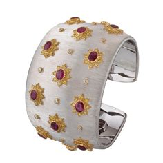 Buccellati Dream 12 cuff with rubies, diamonds, and fancy yellow diamonds set in gold and white gold.