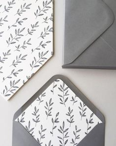 Today I was mostly lining envelopes. Charcoal grey leaves on ivory in grey envelopes.