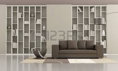 bookcase with sliding doors and brown sofa in a minimalist living room Stock Photo
