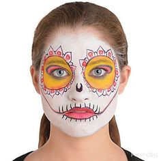 Step 5: Add black details using a black crayon to create flower shapes around your eyes & add lines to your mouth to mimic a skeleton!