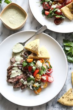 Shake up your Memorial Day grill game with a little Mediterranean inspiration, like these herb marinated steak gyros with tomato-onion salad and green tahini sauce.  Part of this week's Food Network #SensationalSides.