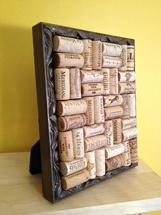 Made using an old picture frame and wine  corks! Can be used as a trivet and when not being used it can stand up as kitchen decoration!