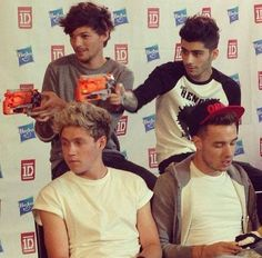 Louis and Zayn playing with there nerf guns. So freaking cute while Niall and Liam just sit there lol