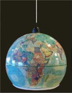 I LOVE THIS!! Vintage world globes have such wonderful charm and character, and while the geographical information may be completely outdated, the shape, colors, and textures can add beauty to any home.  This whimsical world globe pendant light would be a wonderful addition to a home office, a modern living room, or an explorer-themed child's room.