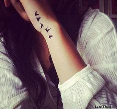 five birds wrist tattoo up hand