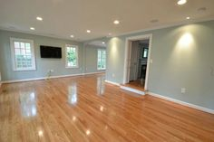 Wall color with white trim and wood floors