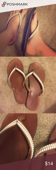 American Eagle Flip Flops Slightly worn, but still in great shape. Beaded decoration, leather sole. Size 10 American Eagle Outfitters Shoes Sandals