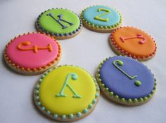 Monogramed sugar cookies.  I might be able to figure out how to do these.