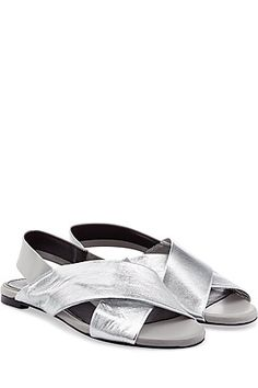 The typically understated silhouette of Robert Clergerie's metallic leather sandals make them a timeless choice with plenty of cool factor #Stylebop