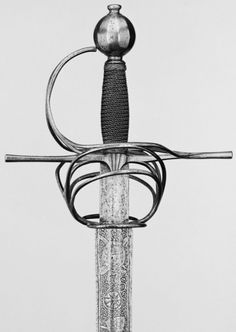 The sword features a steel hilt with an owl's egg pommel with a tang button, long slender straight quillons knuckleguard and a pair of large arms with three rings on end. The barrel-shaped grip is bound with brass wire, while the straight two-edged blade has a central fuller etched in relief.