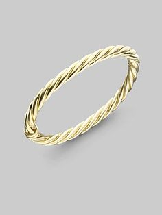 David Yurman: gold cable bracelet. I would want three of these so I could stack them together