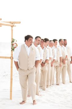Casual, Calm, and Confident groom and his matching groomsmen in light tan vests for a Pensacola Beach wedding