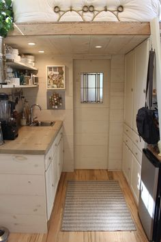 An owner-built 160 square feet tiny house on wheels that houses three people in Massachusetts.