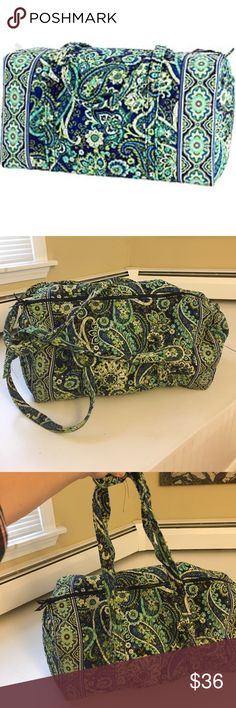 """Vera Bradley Rhythm and Blues large duffel This Vera Bradley duffel is in good used condition with no major flaws and only minor wear and tear. I'm unsure if this is the large or extra large duffel. The measurements are 24"""" across, by 12"""" high and 10"""" wide. This item comes from a pet and smoke free home, offers welcome! Vera Bradley Bags Travel Bags"""