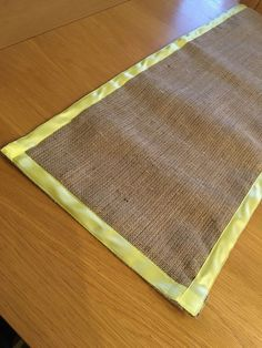 Check out this item in my Etsy shop https://www.etsy.com/uk/listing/285535431/yellow-satin-ribbon-edged-hessian-table