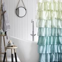 Transform a white bathroom with this unusual frill shower curtain. Photography: Mark Scott. Find more bathroom ideas at housebeautiful.co.uk