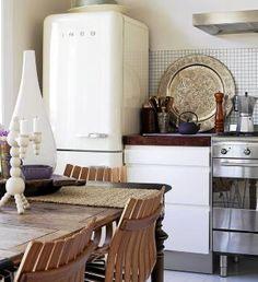 "perfect ""undecorated"" kitchen with smeg fridge.  Love."