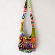 Patchwork Crazy Quilt Hobo Bag, Boho Bag, Sling Bag, Upcycled, Bright, Colorful, Hippie Purse, Crossbody Bag. $30.00, via Etsy.