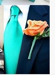 Navy suit/turquoise tie