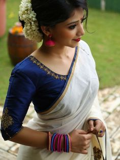 Navy blue blouse with Kerala saree Kerala Saree Blouse Designs, Blouse Designs Silk, Saree Blouse Patterns, Simple Blouse Designs, Onam Saree, Handloom Saree, Anarkali, Lehenga, Stylish Blouse Design