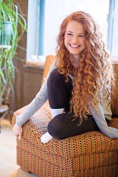 Long spiral curls on redhead  She's pretty