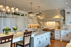 I like the kitchen table incorporated into the extra long island, and the floor to ceiling pantry cabinets, and furniture leg detail  Georgian-Colonial-Kitchen-037.jpg 418×277 pixels