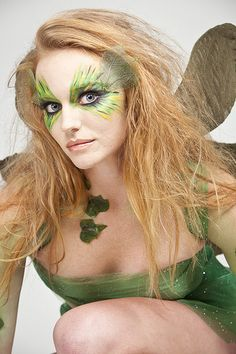 Fairy face paint See website. She has leaves gluedto he sides of her eyes veryco  ol. Great Wild hair too
