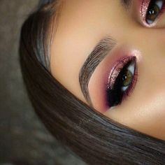 Natural tapered brow with pink eyeshadow and shimmer on the lid with black out corner makeup look.