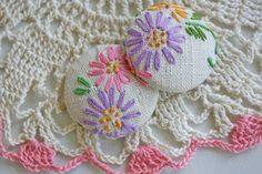 Old scrap of needlework made into covered buttons.