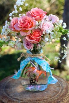 Cute table centerpiece from this Vintage Cowgirl themed birthday party with Lots of Really Cute Ideas via Kara's Party Ideas | Cake, decor, cupcakes, games and more! KarasPa...
