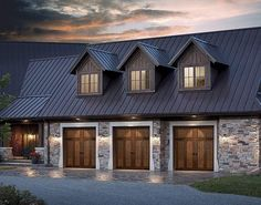 like the spot lights on the garage doors. also like the brick