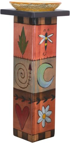 Large Pillar Candle Holder – Colorful candle holder with rosy hues and block icons Large Pillar Candles, Pillar Candle Holders, Yard Art Crafts, Wood Yard Art, Handmade Candle Holders, Peace Pole, Garden Poles, Pole Art, Yard Ornaments