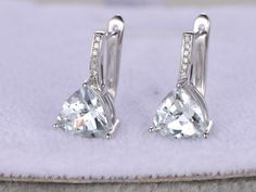 Aquamarine Earrings White gold, 14K&18K Rose/Yellow/White Gold Available. Every Jewelry in my store needs making to order.If you have the stone,you can ask us custom make this setting.[Item details]Solid 14K White Gold(Can be made in white/yellow/rose gold)Size: 8*15.5mm2.55ct trillion Cut IF Natural Blue Aquamarine(A pair,total 2.55ct)0.06ctw Round Cut SI-H Natural Conflict Free DiamondsProngs,Pave,Bezel SetEstimated Retail Price: $1500------See our aquamarine jew...