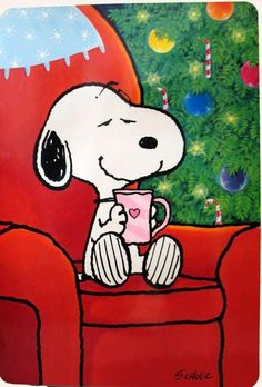 Snoopy with a cup of tea at Christmas.                                                                                                                                                                                 Plus