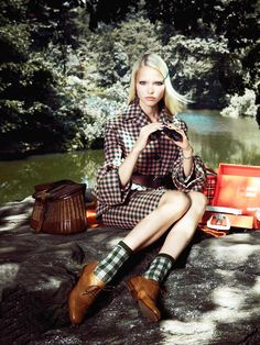 Plaid two piece, oxfords, and brown wicker bag // Vogue China