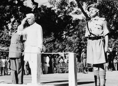 Jawaharlal Nehru salutes the flag as he becomes independent India's first Prime minister on August 15, 1947 during the Independence Day ceremony at Red Fort, New delhi India