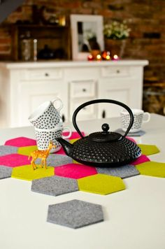 Create a set of felt hexagon trivets with this kitchen tutorial.
