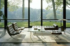 International Style - Philip Johnson's Glass House as inspiration - Barcelona Chairs designed by Mies van der Rohe