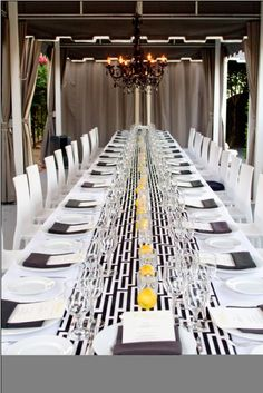 A black #chandelier is a great focal point for this long table setting at Viceroy Palm Springs