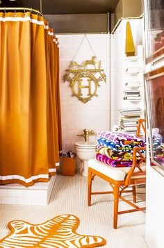 orange and brown + penny tile floor (Trend Alert: Power Curtains | MyDomaine)